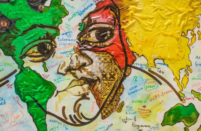 Painting of person with map on face