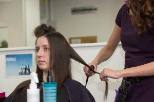 Women practicing beauty techniques inside priosn
